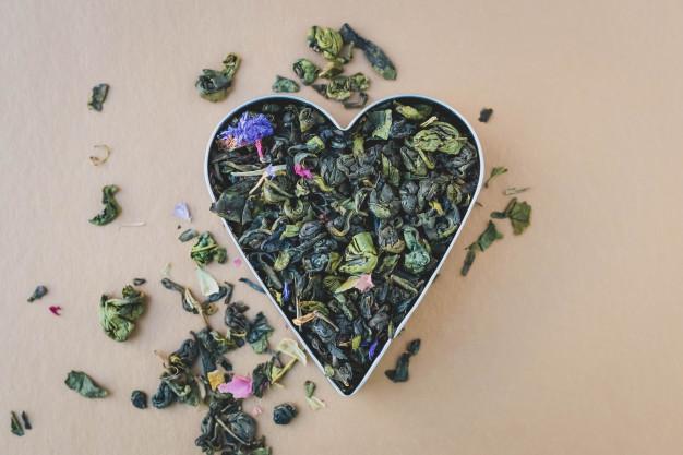 heap-green-tea-leaves-heart-shaped-mix-herbal-tea_156843-165